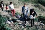 Boys, walking, soccer ball, trash, Colonia Flores Magone