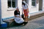 Women, native dress, hats, brick road, building, Holland, PFSV04P15_19