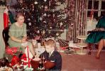 Woman, tree, decorations, poinsettia, boy, presents, 1940s, PHCV01P01_08