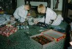 Boys playing with their new Christmas toys, army, presents, pajamas, 1950s