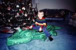 boy, tree, blow-up alligator, Christmas Morning, 1960s