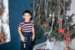 boy, cowboy, smiles, tree, tinsel, Decorations, Ornaments, Christmas Tree decorated, 1950s, PHCV03P05_09