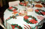 Dinner, table setting, wreath, bells, cookies, gingerbread men, tablecloth, 1950s