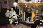 woman, man, girl, boy, daughter, son, stockings, mantle, ribbons, lamp, Fireplace, Family, 1940s