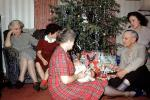 Opening Presents, Gifts, tinsel, baby, grandma, grandmother, mother,  1950s, 1950s