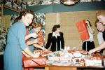 wrapping presents, women, fun, funny, party, 1950s