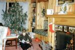 boy reading, fireplace, sitting, Tree, Presents, Gifts, Decorations, Ornaments, 1950s, PHCV04P06_05