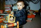 Jack-in-the-Box, boy, Unwrapping Presents, 1950s