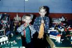 Boys, toy trainset, toot horns, 1950s