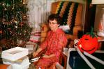 Woman opening Presents, unwrapping, mod dress, cateye glasses, Tomato, 1950s