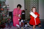 Mother and Daughter unwrapping presents, 1950s
