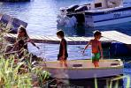 small rowboat, docks, water, boy, girls, Noumea, New Caledonia