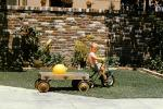 Backyard, tricycle, brick fence, wooden Delux wagon, boy, July 1961, 1960s