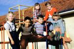 girls and boys on a junglegym, smiles, smiling, cute, 1952, 1950s
