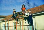 girls and boys on a junglegym, 1952, 1950s