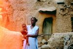Mother with her child, home, building, Mud Brick House