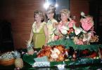 Flowery Dress, Lei, smiles, food table, beehive hairdo, blondes, October 1964, 1960s, PORV24P09_12