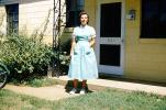 Woman, Front yard, female, home, house, 1950s, PORV26P12_13