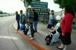 Woman, men, child, stroller, border crossing