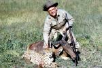 Cheetah poaching, Poacher, Hunter, poached, rifle, African Antelope, Africa, African, 1951, 1950s, PRGV01P10_12B