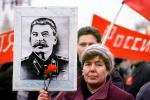 Woman holding up Stalin Poster, Pro Communism Rally, Moscow, Russia, PRSV08P08_16