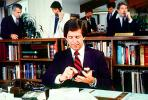 Busy office, workers, employees, phone, desk, many people, traders, brokers, stocks and bonds, 1984, 1980s, businessman, PWWV01P10_10
