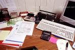 calculator, keyboard, radio, clutter, radio, cordless phone, desk, paperwork, rolodex, PWWV06P14_14