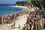 crowds, beach, sand, over population, ocean, water, mass humanity, 1950's, RVLV01P02_11