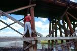 Man walking on a wooden beam, Train Trestle
