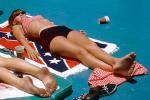 laying on a confederate flag, racist, dirty feet, 1965, 1960s, RVLV07P07_16B