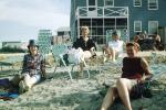 Women, lounge chairs, beach, 1950s
