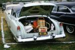 Cadillac, trunk filled with picnic baskets, open trunk, bumper, 1955, 1950s, RVPV01P04_19