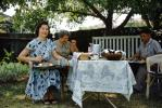 Women Eating, Table, meat, backyard picnic, 1950s, RVPV01P10_12