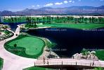 putting green, water hazard, bridge, paths, palm trees, mountain range, Palm Springs