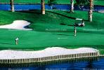 sand trap, water hazard, lake, golfer, golf cart, Palm Desert, California