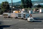 San Francisco International Airport (SFO), ground personal, carts, baggage tractors, TAAV02P01_08.1694