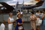 N476A, Martin 404, Mother, Daughter, smiles, Passengers waiting to board flight, 1950s