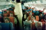 Women, Woman reading Newspaper, Seating, Seats, Full Cabin, April 1975, 1970s, TAIV02P06_15
