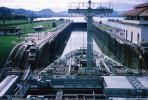 a ship about to go through a partially open lock in the Panama Canal, Mules, Cog, Railway, Rail, Gatun Locks, 1966, 1960's