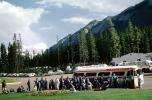 Passengers, Band Boarding Bus, Trailways Bus, cars, automobiles, vehicles, Banff, Alberta, Canada, 1962, 1960s