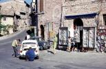 Street scene, buildings, car, Assisi Italy, minicar, Fiat mini-car, October 1969, 1960s, VCOV01P01_17