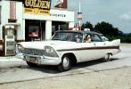 Golden Esso Extra, 1957 Plymouth Belvedere, Garage, Pumps, man, driver, person, automobile, Tail Fins, four-door sedan, car, 1950s