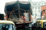 Man sits at the back of a truck, Mumbai (Bombay), India, VCTV01P02_08