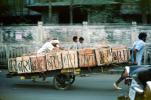 Men pushing and pulling on a cart with bricks, on the Streets of Mumbai