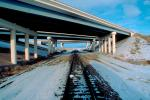 Interstate Highway I-80 overpass, Railroad Tracks in the Snow, Brush, Shrub, Ice, Cold, Cool, Frozen, Icy, Winter, hills, mountains, VRFV03P04_18.3290
