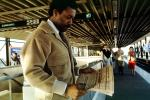 Man reading a newspaper, Daly City Station, Bay Area Rapid Transit, BART, commuters, 1980s, VRHV02P02_08