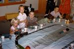 Girls and Boys Celebrating a Birthday around a Toy Train Set, 1950s