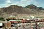 Cars, shopping center, automobiles, mall, buildings, mountains, desert, 1970's, CCAV01P10_02