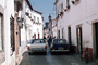 Cars, Stingray Bicycle, narrow cobblestone street, Spain, July 1974, 1970's, CEOV03P03_09