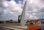 Curacao Monument to Victims of WWII, female sculpture, clouds, harbor, Willemstad